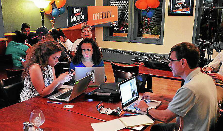 (Peter Casolino ? New Haven Register)  Supporters look at early results at primary night headquarters in New Haven. Photo: Journal Register Co.