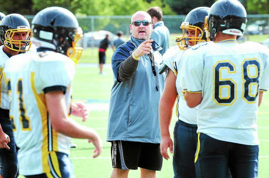 East Haven head coach Anthony Lucibello, center, directs practice on Monday. Photo: Arnold Gold — Register
