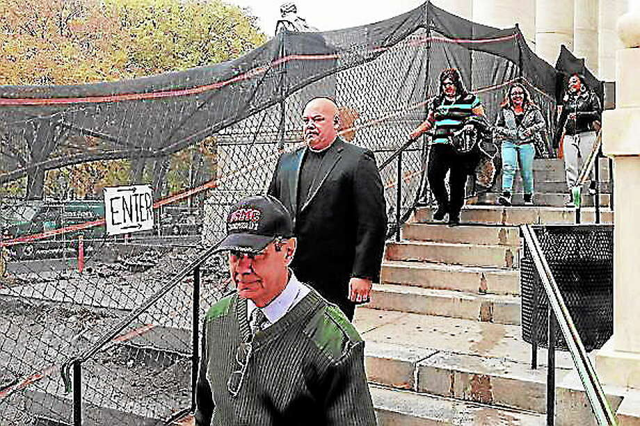 Angelo Appi Jr., rear, follows his father, Angelo Appi Sr., foreground, out of Superior Court in New Haven Oct. 30 after pleading not guilty to a breach of peace charge. Photo: Evan Lips — New Haven Register File Photo