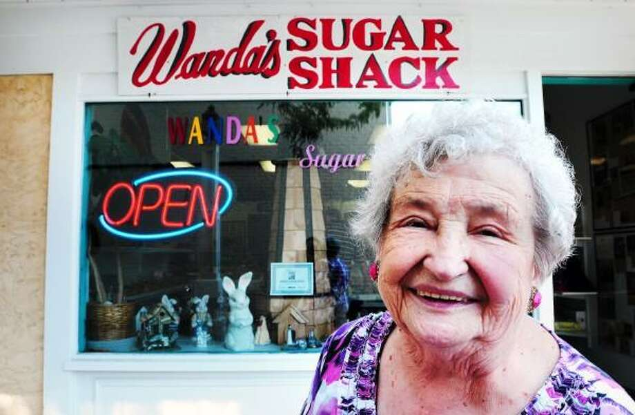 Wanda Hornack is photographed in front of her store, Wanda's Sugar Shack, on Harborwalk in downtown Milford on 6/10/2012. Photo by Arnold Gold/New Haven Register   AG0452E
