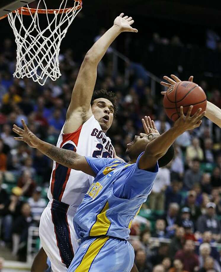Gonzaga's Elias Harris, left tries to block the shot of Southern University's Jameel Grace in the first half during a second-round game in the NCAA college basketball tournament in Salt Lake City, Thursday, March 21, 2013. (AP Photo/George Frey) Photo: AP / FR10102 AP