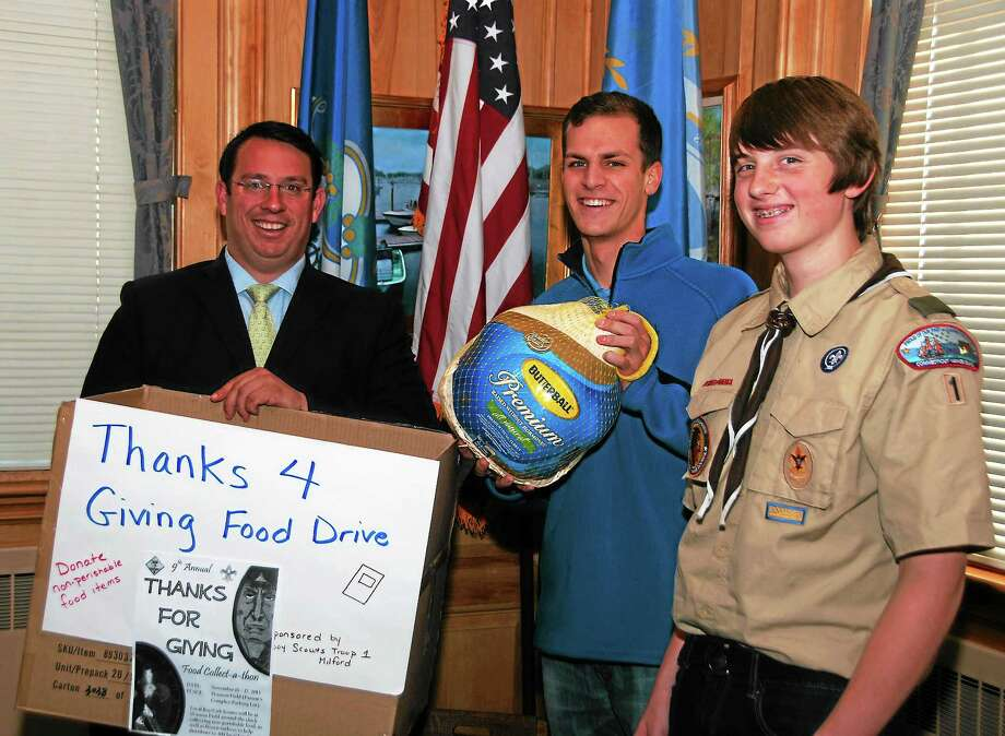 Troop 1, Milford Scouts Josh Paton, center, and Paul Johnson, right, thank Mayor Benjamin G. Blake for his support of their annual food collection for the needy, which is this weekend. Photo: Journal Register Co.