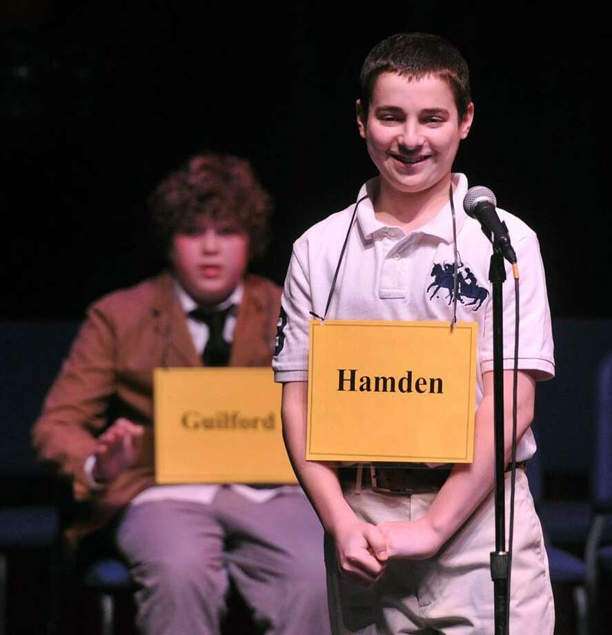 New Haven-- Anthony Capasso, 13, from Hamden Hall, smiles as he wins the New Haven Register Spelling Bee at SCSU's Lyman Hall. Behind him is Max Martin, 14, of E.C. Adams Middle School in Guilford, who came in 2nd place.  Photo-Peter Casolino/Register