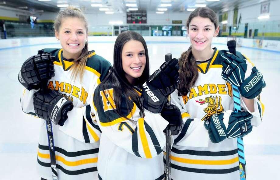 From left, Hamden hockey captains Rachel Ugolik, Nicki Pierne and Heather DelCervo at Astorino Rink in Hamden. (Arnold Gold/Register)
