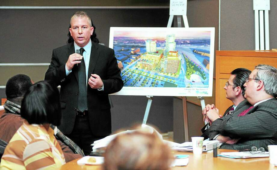 Max Reim, left, principal of LiveWorkLearnPlay, gives a presentation about plans for the former Coliseum site to the Board of Alderman, residents and other stakeholders at New Haven City Hall Wednesday. Photo: Arnold Gold — New Haven Register