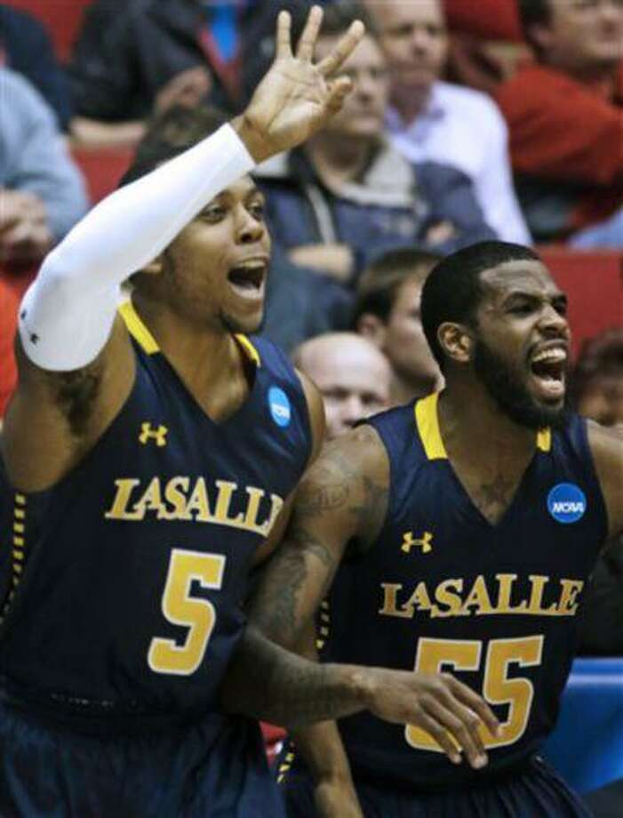 La Salle's Ramon Galloway (55) and Taylor Dunn (5) cheer from the bench after a teammate scored against Boise State in the second half of a first-round game of the NCAA college basketball tournament, Wednesday, March 20, 2013, in Dayton, Ohio. Photo: AP / AP