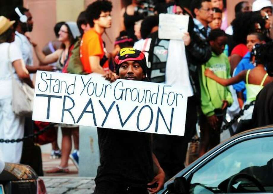 July 15, 2013, protestors of the George Zimmerman verdict, including Michael Gibbs of New Haven, gathered in front of New Haven's Amistad Memorial. Mara Lavitt/New Haven Register
