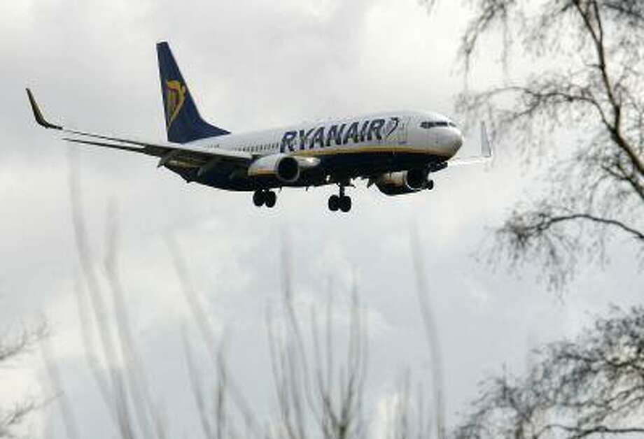 A Ryanair aircraft comes in to land at Liverpool's John Lennon Airport in Liverpool, England, Friday Feb. 20, 2009. Ryanair Holdings PLC began offering a mobile phone service for calls, text messaging and e-mails on some of its flights on Thursday, becoming the first budget carrier in Europe to test the use of cell phones in flight. (AP Photo/Paul Thomas) Photo: ASSOCIATED PRESS / AP2009