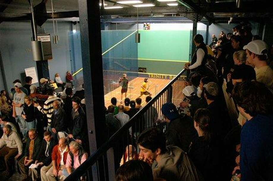 Spectators crammed the lofts to watch Princeton University's  David Letourneau in a match against Trinity College's Manek Mathur, Jr. (yellow jersey)  at the George A. Kellner Squash Center on the campus of Trinity College in Hartford, Conn., on Jan. 30, 2008.   Letourneau won the match with scores:  7-9, 9-7, 9-1, 9-5.  (AP Photo/George Ruhe) Photo: ASSOCIATED PRESS / AP2008