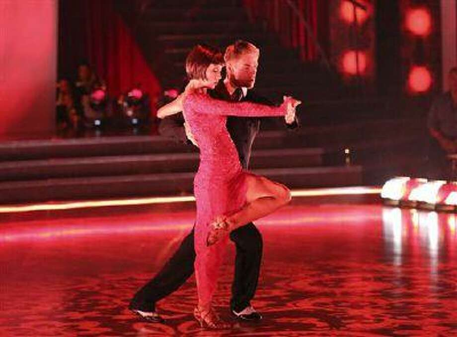 """Country singer Kellie Pickler and her partner Derek Hough perform on the celebrity dance competition series """"Dancing with the Stars,"""" in Los Angeles. Pickler won the mirror ball trophy Tuesday. (AP Photo/ABC, Adam Taylor) Photo: AP / American Broadcasting Companies,"""