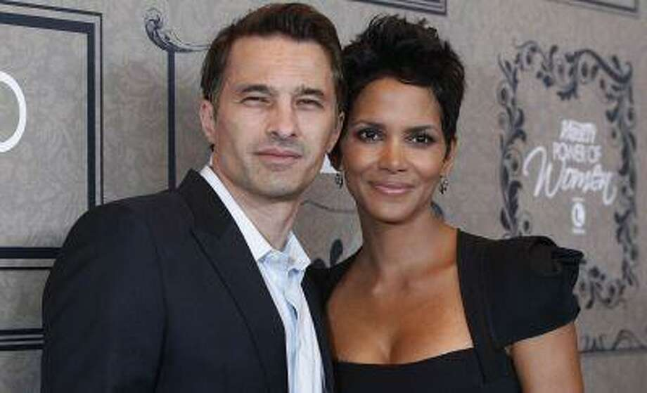 Actress Halle Berry and her partner Olivier Martinez pose at Variety's 4th Annual Power of Women event in Beverly Hills, California in this October 5, 2012 file photo. Berry and French actor Martinez were married over the weekend in France, her representative said on July 14, 2013. REUTERS/Mario Anzuoni/Files Photo: REUTERS / X90045