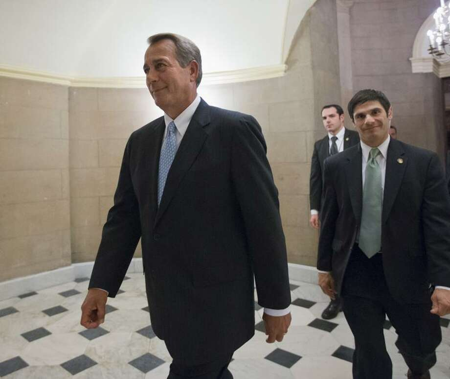 FILE - This Jan. 15, 2013 file photo shows House Speaker John Boehner of Ohio walking on Capitol Hill in Washington. Republican leaders scramble for votes on a stopgap debt-limit measure that would let the government keep borrowing until at least mid-May, giving up for now on trying to win spending cuts from Democrats in return. But the respite would be only temporary, with major battles still to come between the GOP and President Barack Obama over taxes, spending and deficits. (AP Photo/J. Scott Applewhite, File) Photo: AP / AP2013