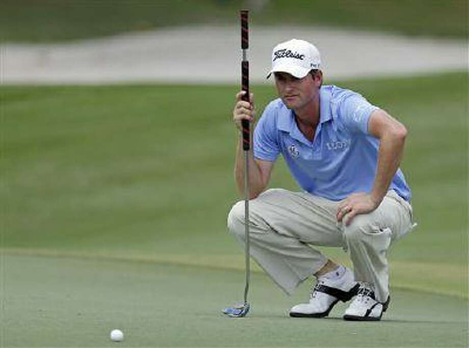Webb Simpson looks over his putt on the second green during the third round of The Players championship golf tournament at TPC Sawgrass, May 11, 2013, in Ponte Vedra Beach, Fla. Photo: AP / AP