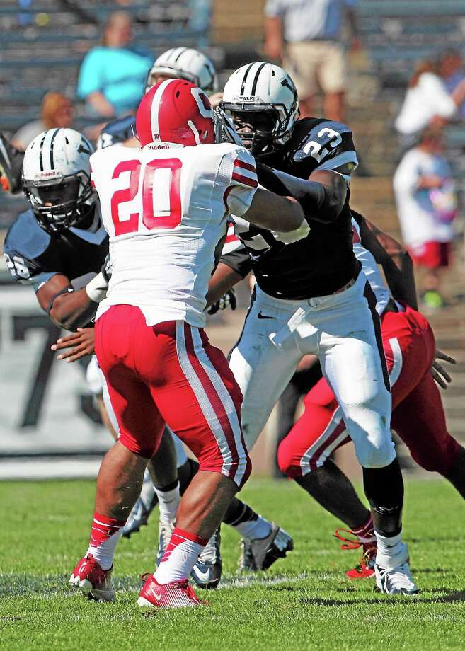 Defensive back Foyesade Oluokun and the Yale defense stepped up in Saturday's win over Brown. Photo: Submitted Photo   / 2013 All Rights Reserved
