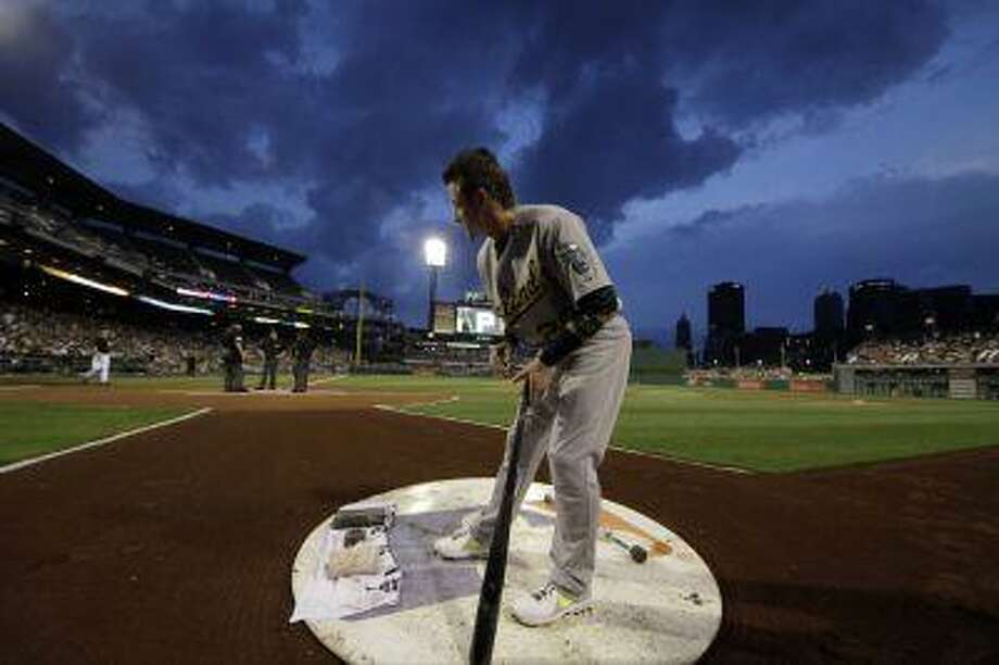 Oakland Athletics third baseman Josh Donaldson (20) gets his bat ready on deck before the beginning of a baseball game against the Pittsburgh Pirates at PNC Park in Pittsburgh Tuesday, July 9, 2013. The Athletics won 2-1. Photo: AP / AP