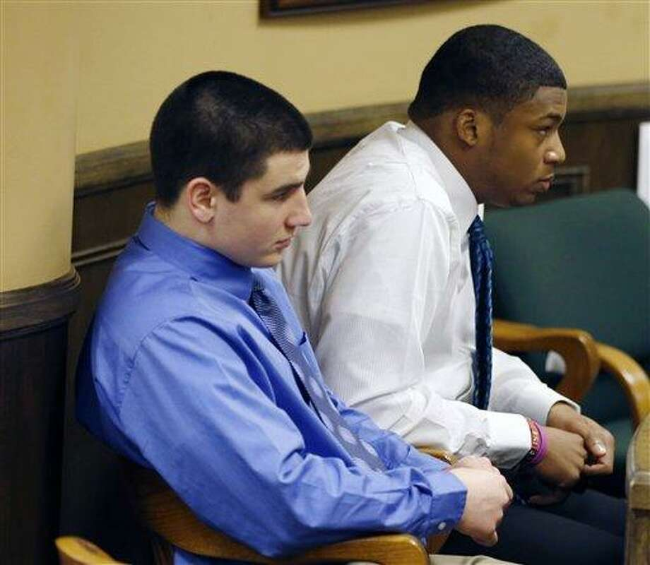 Trent Mays, 17, left, and co-defendant 16-year-old Ma'lik Richmond sit in court before the start of the third day of their trial on rape charges in juvenile court on Friday, March 15, 2013 in Steubenville, Ohio. Mays and Richmond are accused of raping a 16-year-old West Virginia girl in August of 2012. (AP Photo/Keith Srakocic, Pool) Photo: ASSOCIATED PRESS / AP2013