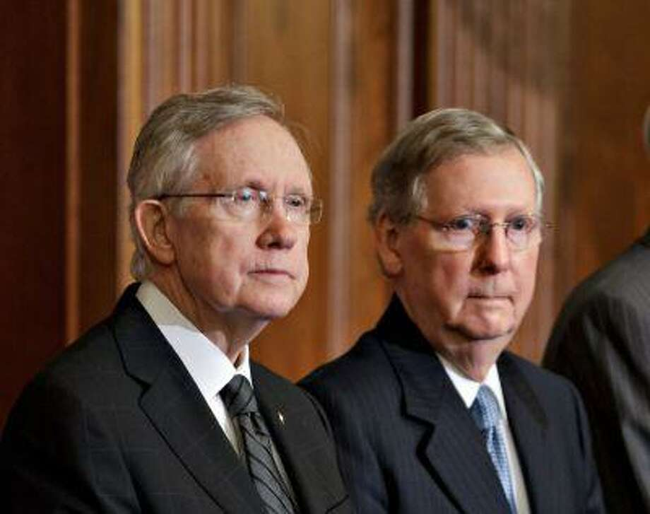 In this photo taken July 11, 2012, Senate Majority Leader, Democrat Harry Reid of Nevada, and Senate Minority Leader, Republican Mitch McConnell of Kentucky, right, participate in an award ceremony at the U.S. Capitol in Washington. Photo: AP / AP