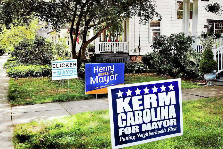 (Melanie Stengel — New Haven Register )  Signs on the lawn of Westville home 9/9. Photo: Journal Register Co.
