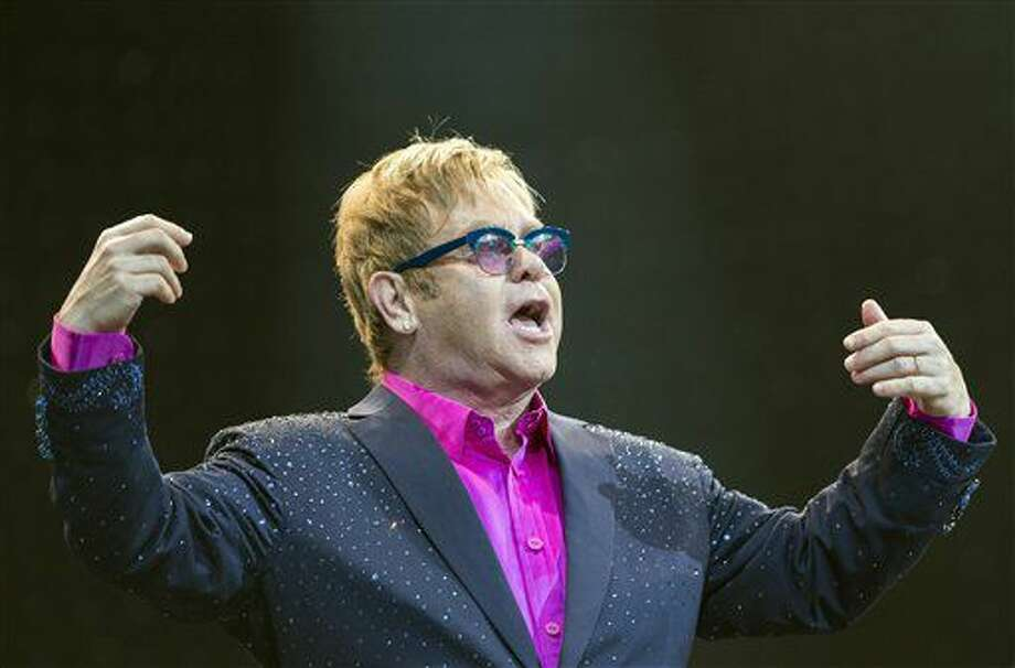 In this picture made available Friday, Sept. 6, 2013, Sir Elton John performs on the Waldbuehne stage in Berlin, Germany, Thursday, Sept. 5, 2013. British musician John gives five concerts in Germany during his 'Greatest Hits Live Tour 2013'. (AP Photo/dpa, Florian Schuh) (Florian Schuh)