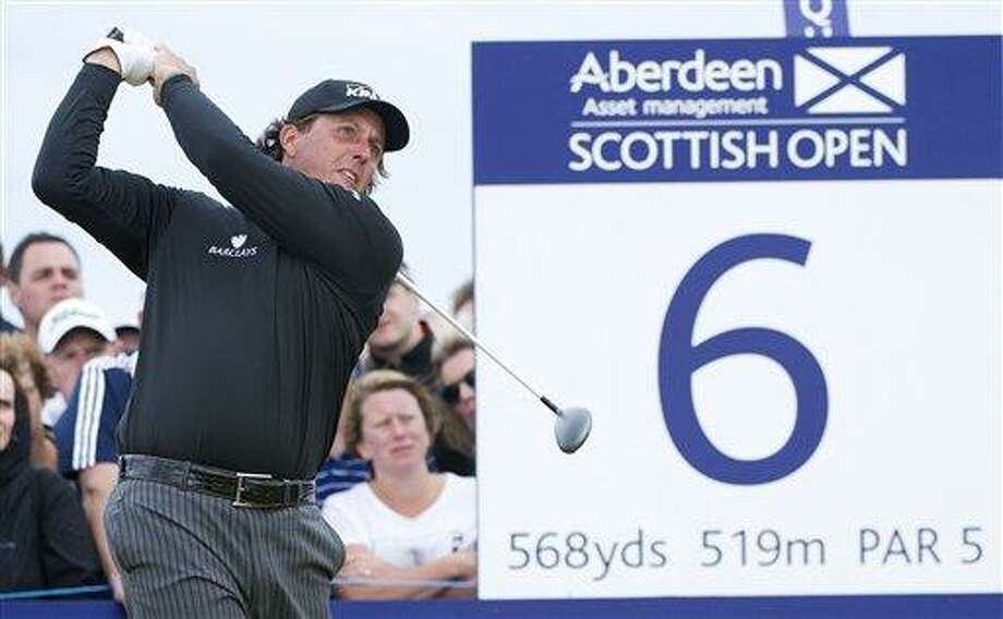 US golfer Phil Mickelson tees off at the 6th hole during day four of the Scottish Open golf championship at Castle Stuart Golf Course, Inverness Scotland Sunday July 14, 2013. (AP Photo/Kenny Smith/PA)  UNITED KINGDOM OUT NO SALES NO ARCHIVE Photo: AP / PA