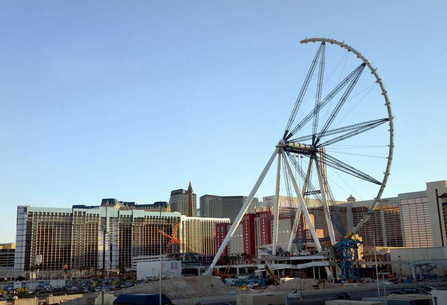In this photo provided by the Las Vegas News Bureau, The High Roller observation wheel is seen halfway completed Wednesday, Aug. 14, 2013 above Caesars Entertainment's $550 million Linq retail-entertainment-restaurant development. When finished, the High Roller will be the largest observation wheel in the world -- bigger than the London Eye or Singapore Flyer. Photo: AP Photo / Las Vegas News Bureau