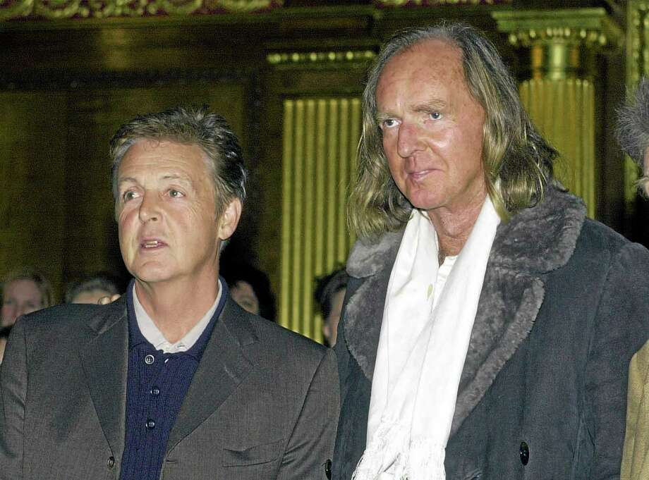 Jan. 27 2011 file photo of Sir Paul McCartney , left, with British composer Sir John Tavener who has died at the age of 69, his music publisher  announced Tuesday Nov. 12, 2013. In the late 1960s he was famously signed to The Beatles' record label Apple and his music was notably performed at the funeral of Diana, Princess Of Wales, in 1997.(AP Photo/ John Stillwell, PA) UNITED KINGDOM OUT  NO SALES  NO ARCHIVE Photo: AP / PA