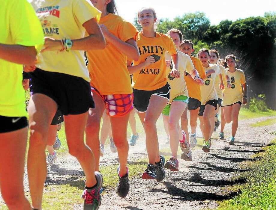 The Amity High School cross-country team runs during a recent practice. Photo: Mara Lavitt — Register   / Mara Lavitt
