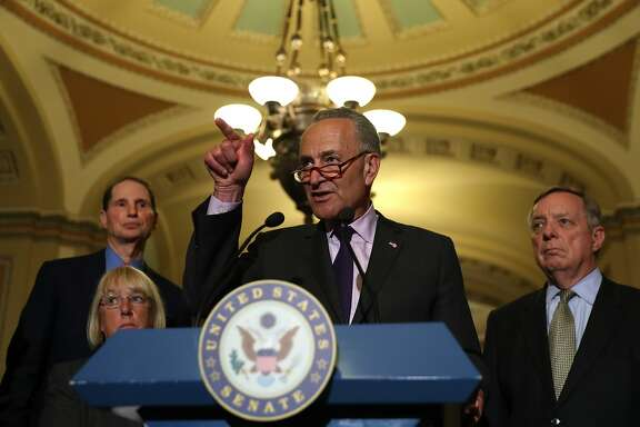 U.S. Senate  minority leader Charles Schumer (C) (D-NY)  speaks to reporters during a news conference on Capitol Hill following a procedural vote on the GOP health care bill on July 25, 2017 in Washington, DC. U.S. Vice President Mike Pence cast the tying vote on a procedural vote to move forward on the GOP health care bill.  (Photo by Justin Sullivan/Getty Images)