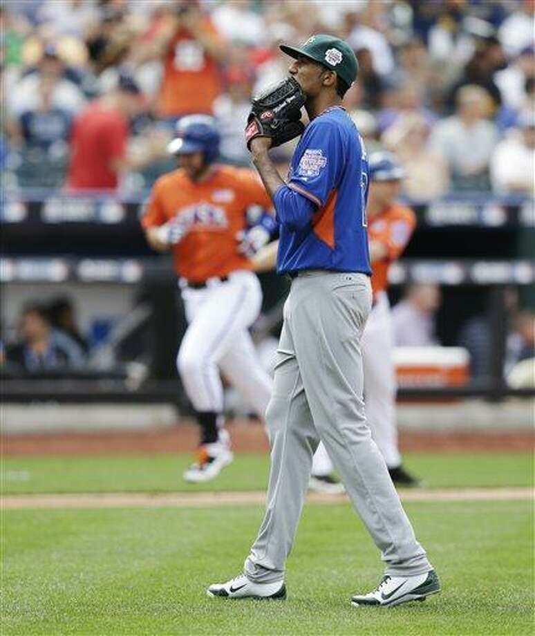 World's Michael Ynoa reacts as United States' Matt Davidson, in background, runs the bases after hitting a home run in the fourth inning of the MLB All-Star Futures baseball game against  Sunday, July 14, 2013 in New York. (AP Photo/Kathy Willens) Photo: AP / AP