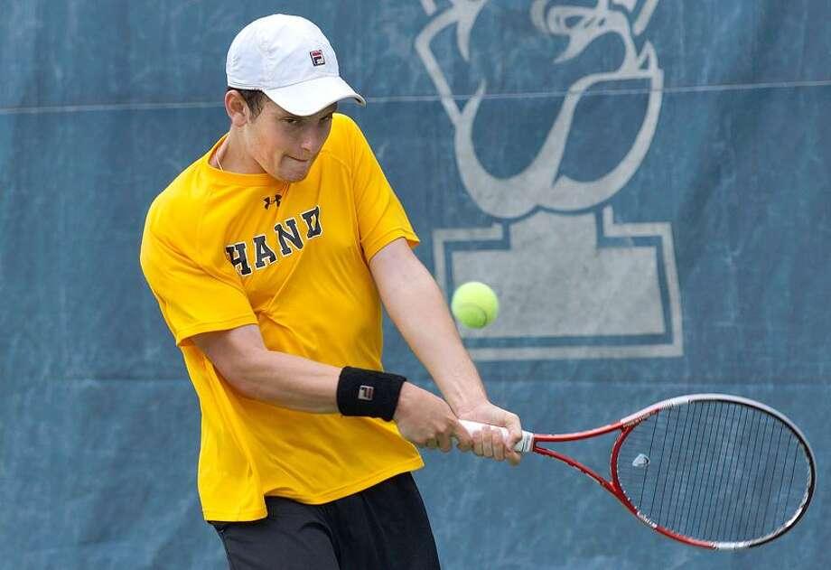 "New Haven-- Hand's Scott Rubinstein returns a second set shot against Amity High's Jason Seidman during the SCC tennis championship at Yale.  Photo-Peter Casolino/Register <a href=""mailto:pcasolino@newhavenregister.com"">pcasolino@newhavenregister.com</a>"