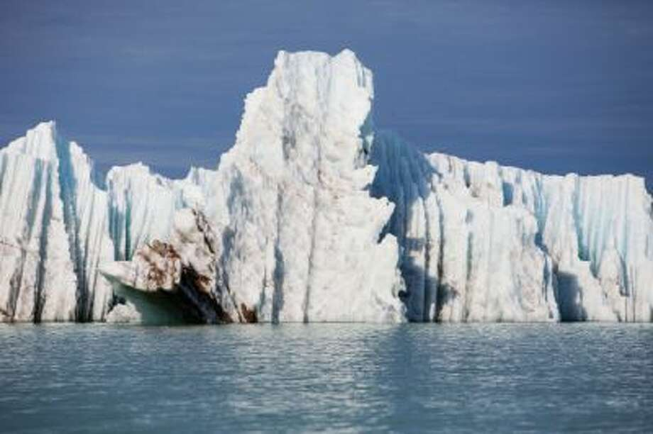 Huge iceberg blue water with blue sky. Photo: Getty Images / (c) Anna Henly