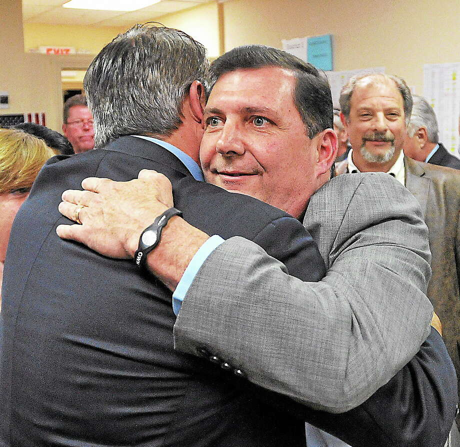 (Peter Casolino — New Haven Register)   West Haven Mayor John Picard congratulates Edward O'Brien after conceding to O'Brien on election night. Picard showed up at O'Brien headquarters to wish him well.  pcasolino@NewHavenRegister Photo: Journal Register Co.