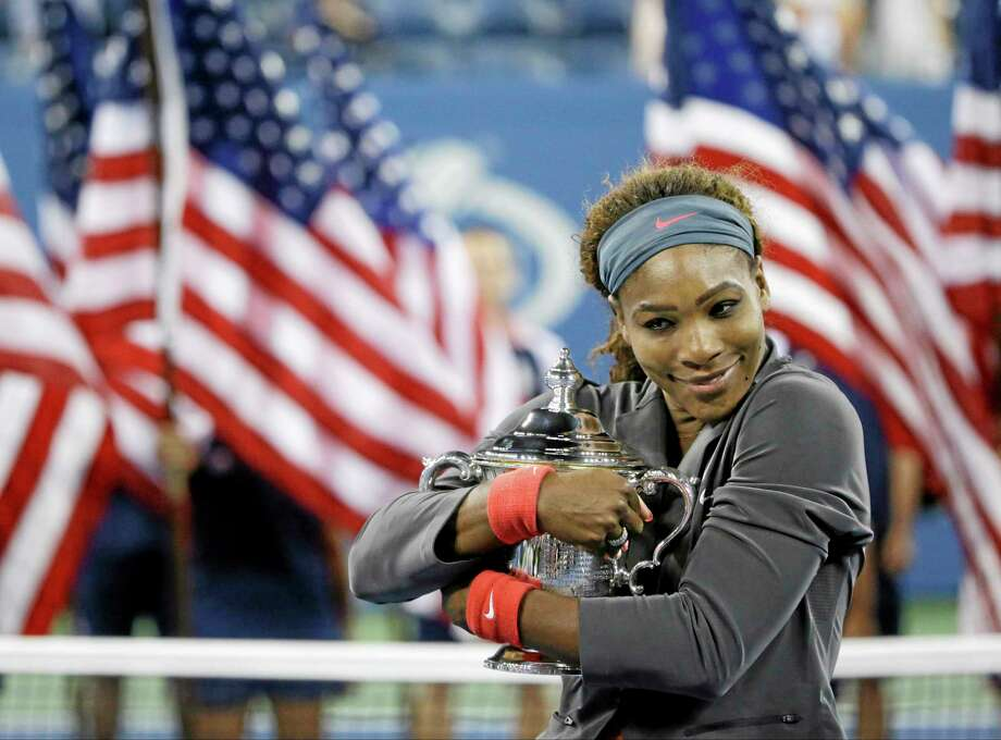 Serena Williams hugs the championship trophy after defeating Victoria Azarenka during the women's final of the U.S. Open on Sunday. Photo: David Goldman — The Associated Press   / AP