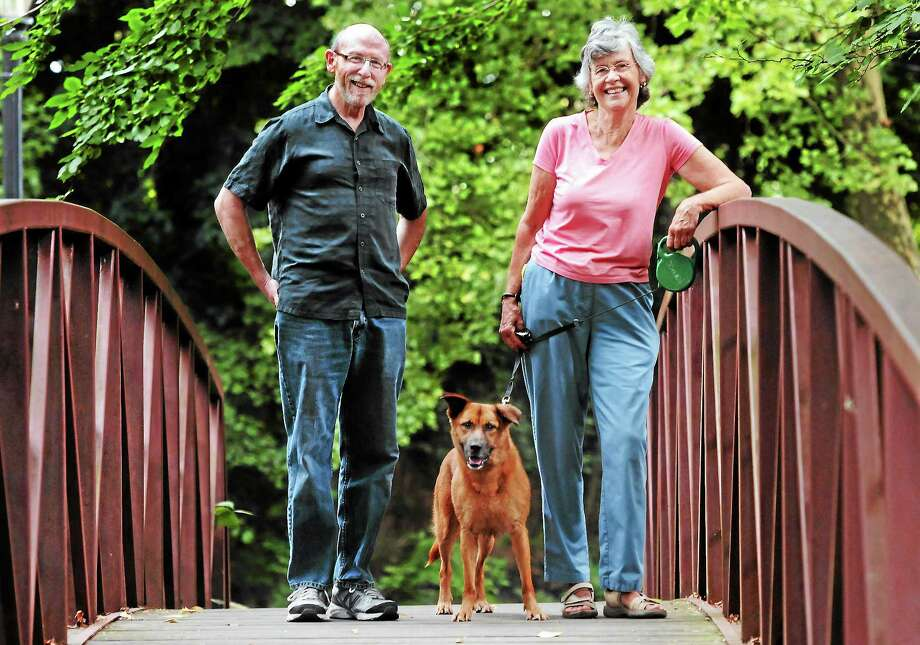 Friends of Edgewood Park in New Haven, Jon Miller and Stephanie FitzGerald with her dog Rudy, both of New Haven, along the Olmsted Carriageway, a feature of the park. Photo: (Mara Lavitt — New Haven Register)