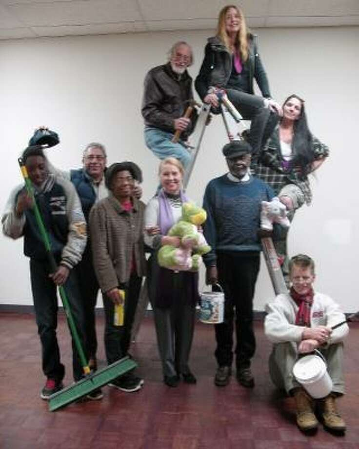Volunteer members of CAFTA were busy preparing for the Carnival of Food and Wine Tasting on Friday. Above, from left, are Darnell Battle, Sam Slaiby, Darlene Battle, (on ladder) Roger Newbury, Terea Sullivan, Suzanne Carcia, John Sullivan, Stella Chau, Bill Battle and Deirdre Houlihan DiCara.