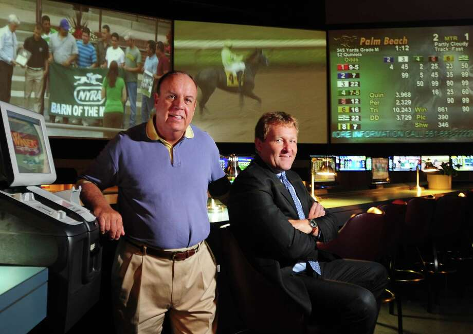 Peter Hvizdak Ñ RegisterState Representative Steve Dargan, D-West Haven, left, and Sportech managing director of sports venues Ted Taylor at Sports Haven in New Haven, Conn. Thursday July 11, 2013.  Taylor's Sportech recently introduced a Connecticut-based online horserace betting operation for the first time and Dargan believes online wagering opportunities will continue in the state. Photo: New Haven Register / ©Peter Hvizdak /  New Haven Register