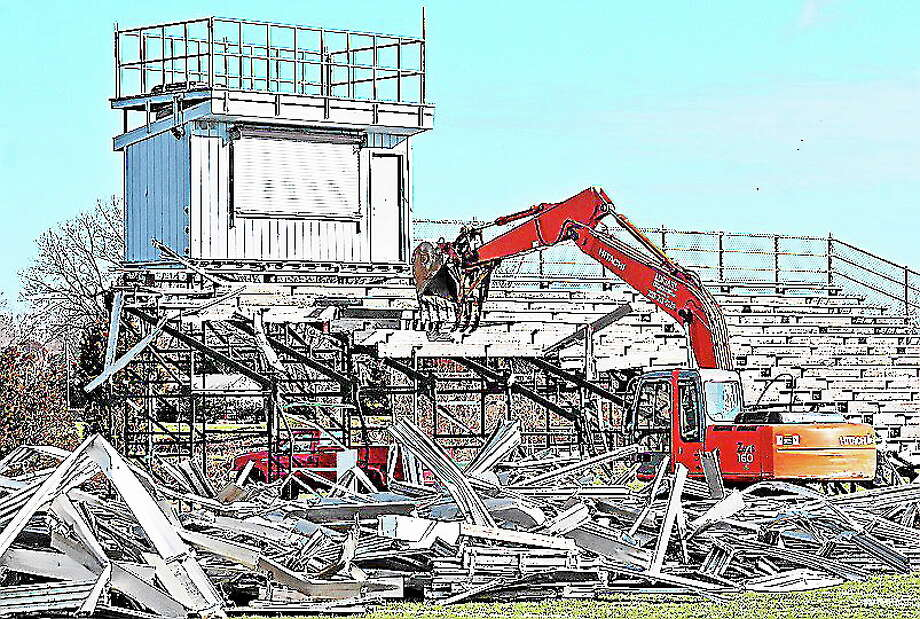 A worker from Lindahl Excavating tears down the bleachers at Strong Field at the Madison Surf Club. Photo: Peter Casolino — Register