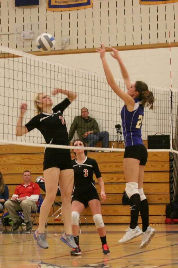 Submitted Photo by CHRISTINE BRYCE Morrisville-Eaton's Jessica Chandler and Mount Markham's Emily Timian compete for a ball at the net during their match in West Winfield on Tuesday, January 22, 2013.