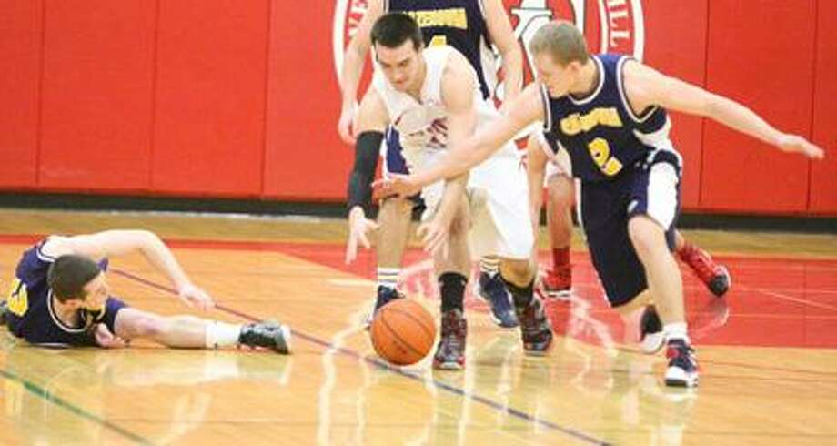Dispatch Staff Photo by JOHN HAEGER (Twitter: OneidaPhoto)VVS' Colby Mason (15) and Cazenovia's Andrew Vogl (2) battle for a loose ball during the first half of their game on Tuesday, Jan. 22, 2013 in Verona.