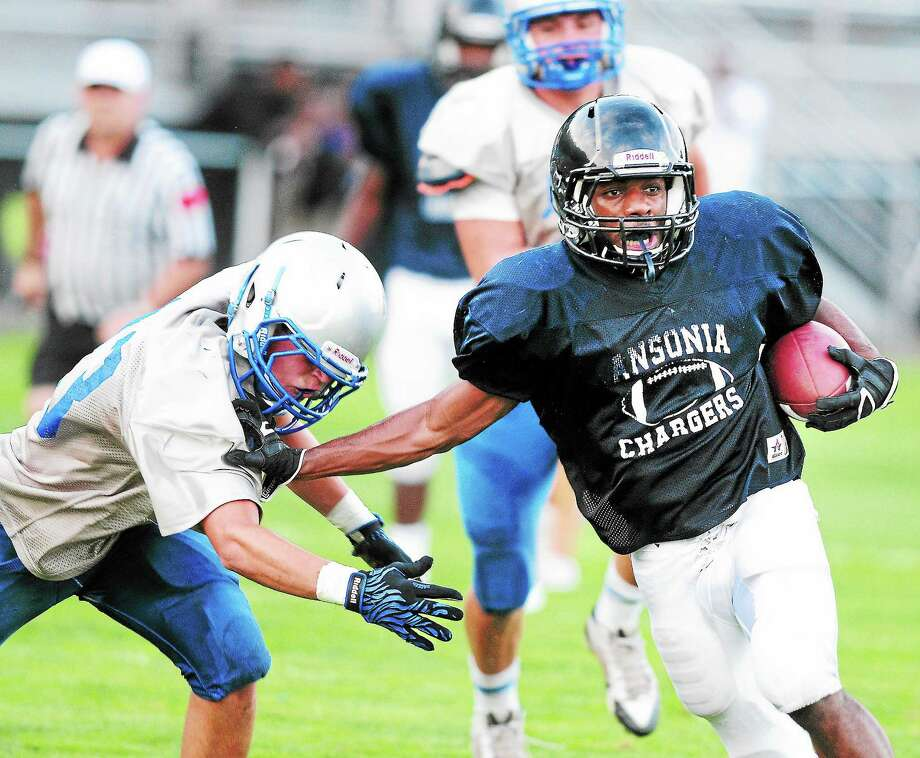 Ansonia's Arkeel Newsome of Ansonia runs the ball during a recent scrimmage against West Haven. Photo: Arnold Gold — Register