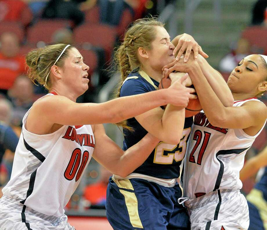 Quinnipiac's Nikoline Ostergaard, center, battles Louisville's Sara Hammond, left, and Bria Smith for the ball during the first half on Monday. Photo: Timothy D. Easley — The Associated Press   / FR43398 AP