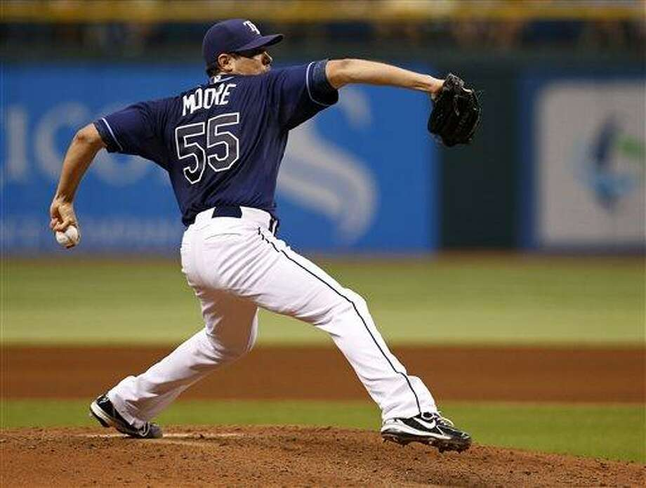 Tampa Bay Rays starting pitcher Matt Moore throws during the sixth inning of a baseball game against the Minnesota Twins Thursday, July 11, 2013, in St. Petersburg, Fla. (AP Photo/Mike Carlson) Photo: AP / FR155492 AP