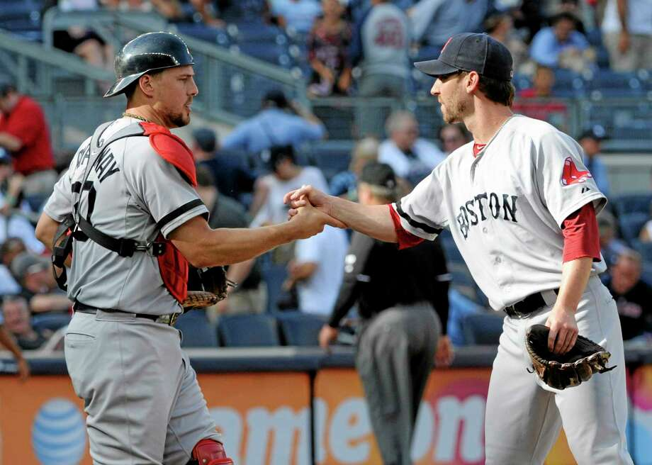 As Register columnist Chip Malafronte points out, former Yalie Craig Breslow, right, has played a key role in the Red Sox's hugely successful season. In case you're wondering, yes, the catcher congratulating Breslow after Boston's 13-9 pounding of the Yankees on Saturday is another ex-Yalie, Ryan Lavarnway. Photo: Bill Kostroun — The Associated Press   / FR51951 AP