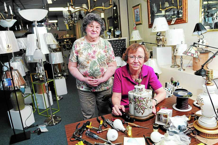 Jackie Kaywood, owner of the Lamp Shoppe, and manager Kathleen Zocco are seen in the Hamden store recently. Photo: (Arnold Gold — New Haven Register)
