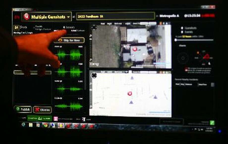 SST ShotSpotter's Scott Beisner points to a demonstration screen of their real-time gunshot date used in their incident review center in Newark, Calif., on Tuesday, June 25, 2013.