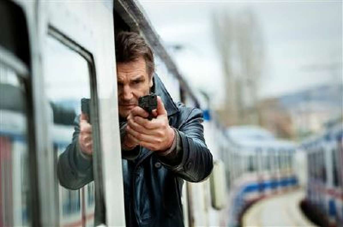 """This image released by 20th Century Fox shows Liam Neeson in a scene from """"Taken 2."""" Gun violence in PG-13 rated movies has increased considerably in recent decades, to the point that it sometimes exceeds gun violence in even R-rated films, according to a study released Monday."""