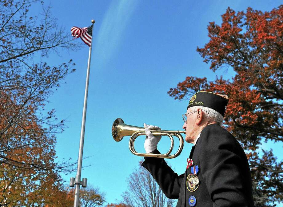 "(Peter Casolino — New Haven Register) WWll Navy veteran, Daniel R. Waleski, 89, ""plays"" taps during the annual Veteran's Day observance ceremony on the Derby Green. pcasolino@NewHavenRegister Photo: Journal Register Co."