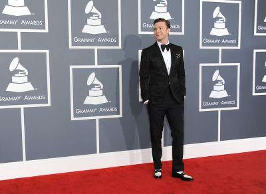 """FILE - In this Feb. 10, 2013 file photo, musician Justin Timberlake arrives at the 55th annual Grammy Awards, in Los Angeles. """"Mad Men"""" star Jon Hamm is going mad over Justin Timberlake's suit and tie, the song and the singer's style. As for Timberlake, Hamm believes the pop star has """"always been a very fashion forward kind of guy."""" (Photo by Jordan Strauss/Invision/AP, File) Photo: Jordan Strauss/Invision/AP / Invision"""
