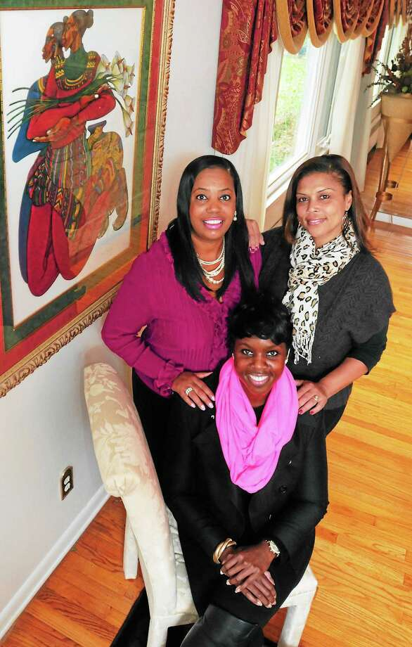 (Peter Hvizdak — New Haven Register)African-american women (left to right) Doris Dumas, Nicole Murphy and Vera Esdaile, all of New Haven, Saturday November 9, 2013,describe what it means to have Toni Harp as their new mayor in New Haven.ee Photo: New Haven Register / ©Peter Hvizdak /  New Haven Register