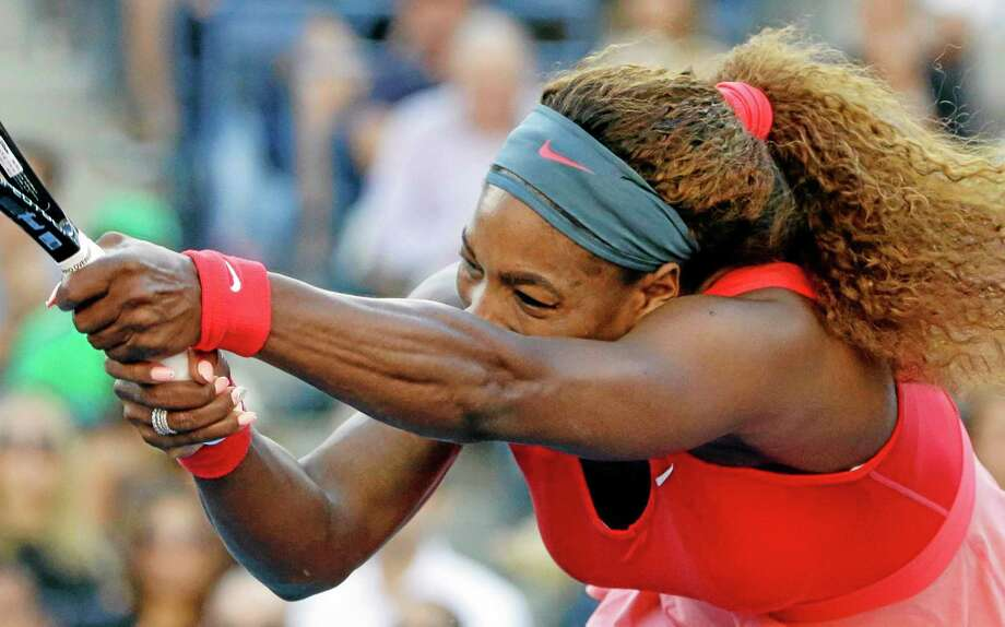 Serena Williams follows through on a shot to Li Na, of China, during the semifinals of the 2013 U.S. Open tennis tournament. Photo: David Goldman — The Associated Press   / AP